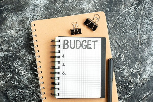 top view budget written note notepad with pen dark surface gray student color school money college business copybook